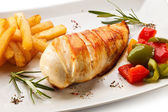 Grilled chicken fillet, French fries and vegetables — Stock Photo