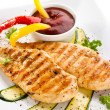 Grilled chicken breasts and vegetables — Stock Photo #33552551