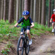 Active family biking — Stock fotografie