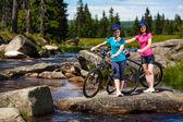 Girls riding bikes — Stock Photo
