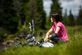 Woman resting after cycling cycling — Stock Photo