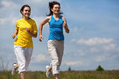 Women running — Stock Photo