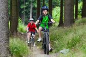 Girl and boy biking — Stock Photo