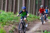 Active family biking — Stock Photo