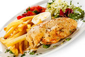 Fried chicken fillet, French fries and vegetables — Stock Photo