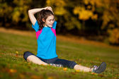 Young girl doing exercises — Stock Photo