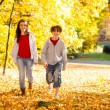 Girl and boy walking in city park — Foto Stock