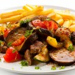 Roasted meat, French fries and vegetables — Stock Photo