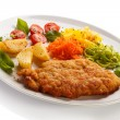 Fried pork chops, baked potatoes and vegetable salad — Stock Photo