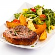 Grilled steaks, baked potatoes and vegetable salad — Stock Photo #33646523