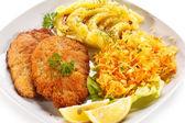 Pork chops, mashed potatoes and vegetable salad — Stock Photo