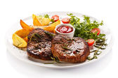 Grilled steaks, baked potatoes and vegetable salad — ストック写真