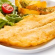 Fish dish - fried fish fillet with baked potatoes and vegetables — Stock Photo #33650701