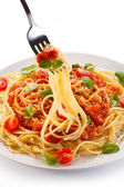 Pasta with meat, tomato sauce, parmesan and vegetables — Stock Photo