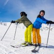 Teenage girl and boy skiing — Stock Photo