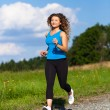 Young woman running — Stock Photo #33759897