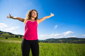 Woman holding arms up — Stock Photo