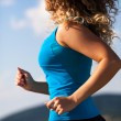 Young woman running — Stock Photo #33760143