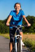 Young woman biking — Stock Photo