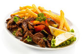 Roasted meat and French fries — Stock Photo