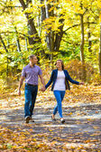 Woman and man walking in park — Stock Photo