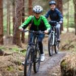 Teenage girl and boy riding bikes — Zdjęcie stockowe