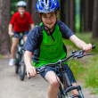 Teenage girl and boy riding bikes — Stockfoto