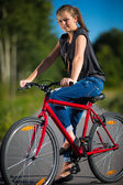 Young woman biking — Stock Photo