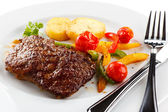 Grilled steaks and vegetable salad — Stock Photo