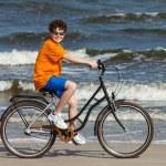 Teenage boy riding bike — Stock Photo #46270799