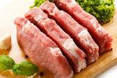 Raw pork chops on cutting board — Stock Photo