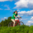 Teenage girl and boy riding bikes — ストック写真