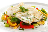 Boiled fish fillet with vegetables — Stock Photo