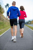 Woman and man running — Stock Photo