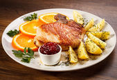 Steak and boiled potatoes — Stock Photo