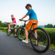 Teenage girl and boy riding bikes — Foto Stock #46959709
