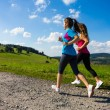 Постер, плакат: Two women running