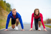 Woman and man exercising — Stockfoto