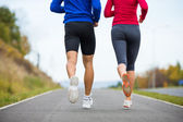 Woman and man running — Stock Photo