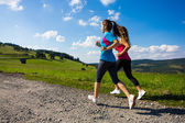 Two women running — Stock Photo