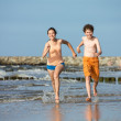 Teenage girl and boy running — Stock Photo #50532379