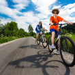 Teenage girl and boy riding bikes — Stockfoto #50530429