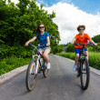 Teenage girl and boy riding bikes — Zdjęcie stockowe #50530581