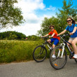 Teenage girl and boy riding bikes — Foto de Stock   #50530769