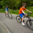 Teenage girl and boy riding bikes — Zdjęcie stockowe #50530827