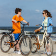 Teenage girl and boy biking — Stock Photo #50532009