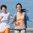 Teenage girl and boy running — Stock Photo #50532329