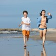 Teenage girl and boy running — Foto de Stock