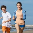Teenage girl and boy running — Stock Photo #50532393