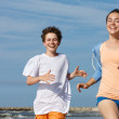 Teenage girl and boy running — Stock Photo #50532403